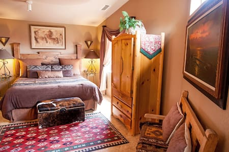 The bedroom has a King bed, HDTV, iPod dock, large armoire, two sinks and a bathroom with a spacious two-person walk-in shower and toilet (with another door to access it from the living room, without entering the bedroom).