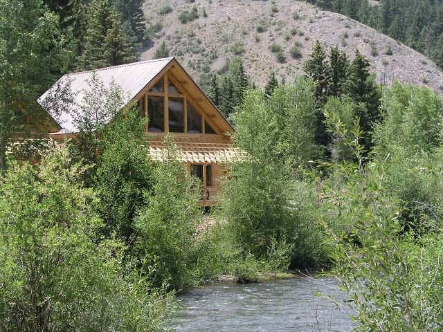 The Columbine Log home (4 queen bed) on the river