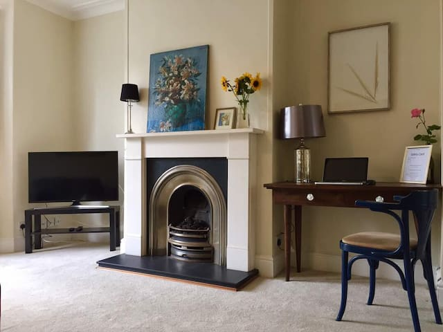 Gas fire place and a office desk in living room