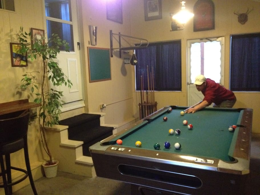 Our billard game room is a great place to hang out and meet new people. It also accommodates our smoking guests.