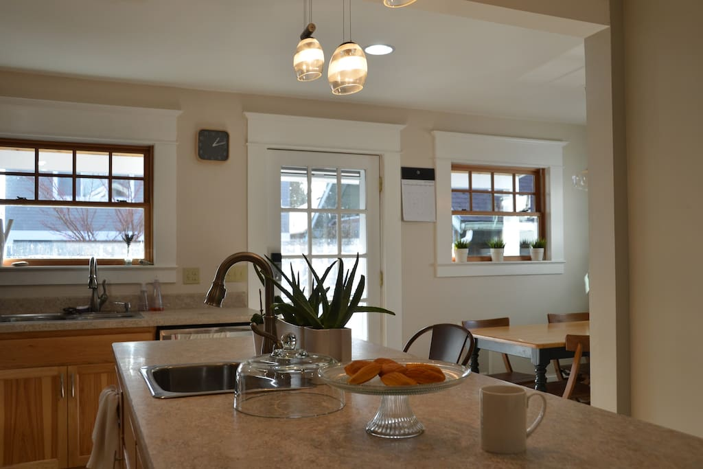 The kitchen was recently remodeled to add a breakfast nook and custom hickory cabinets.