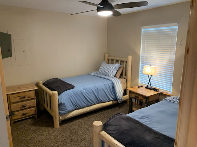 """Downstairs bedroom (two twin-sized beds and a 32"""" television)."""