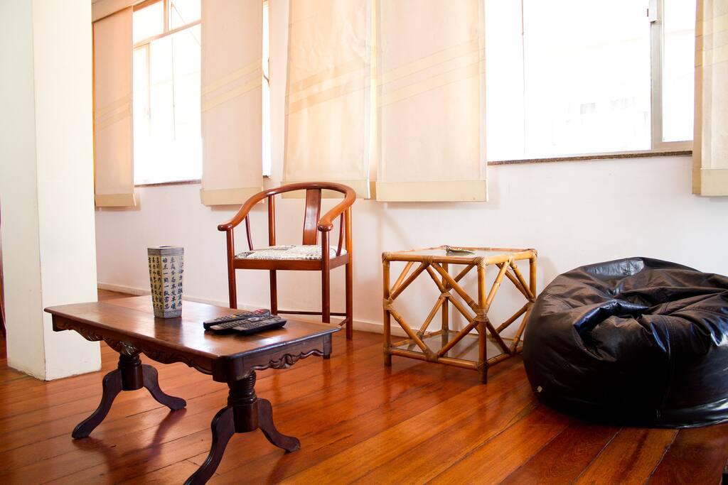 Living room:  LED TV, dinner table, bar