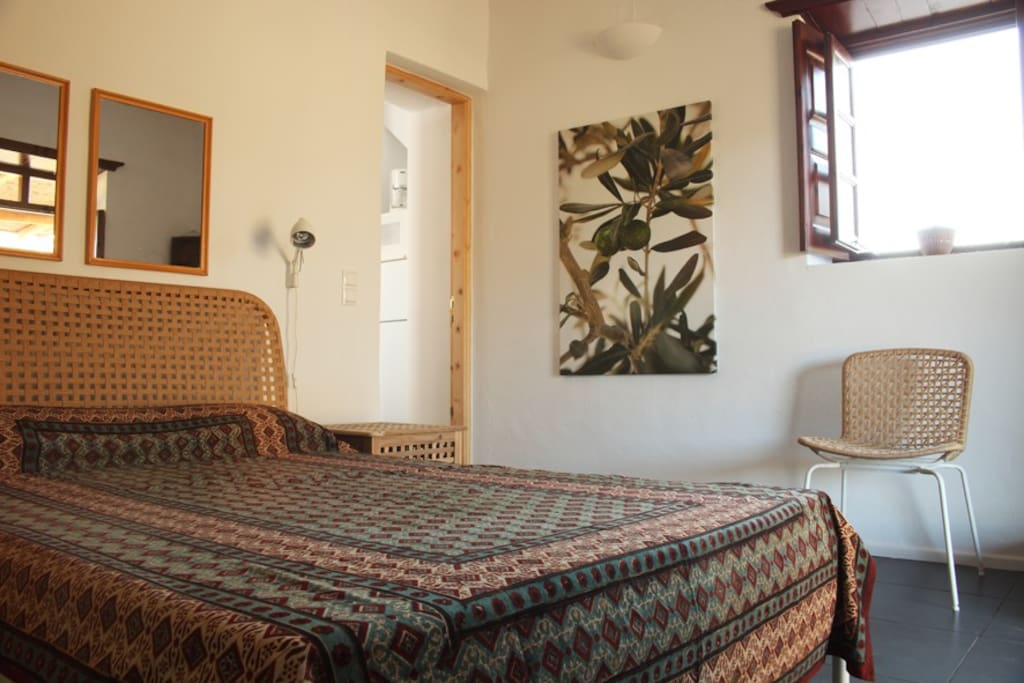 Bedroom with double bed, illuminated by the Greek sunlight!