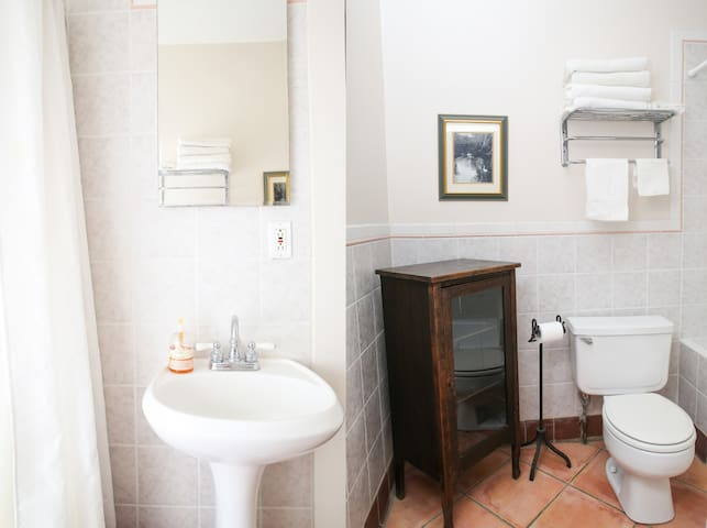 Enjoy a tiled bathroom with ample storage for your things, soft towels and supplies.