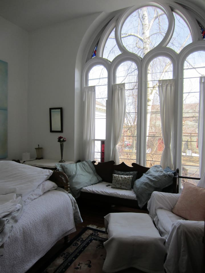 The Chapel room has a double bed, settee, armchair, writing desk and armoire.