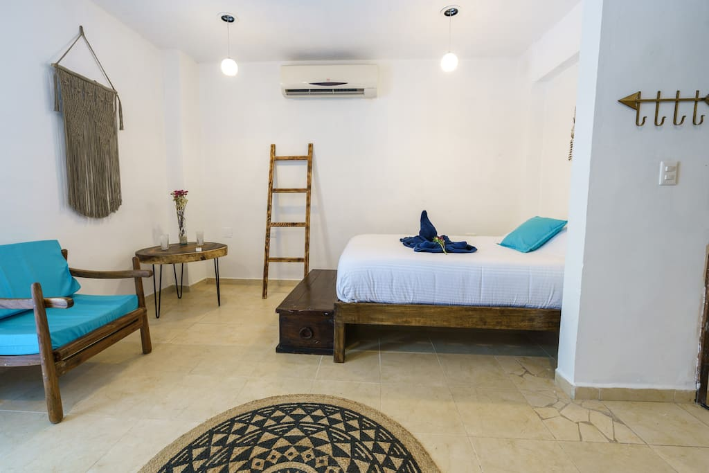 Room with private bathroom and balcony perfect for a couple or two friends that do not mind sharing a bed.