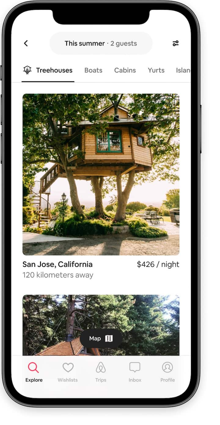 Browse listings for treehouses in the Airbnb app.