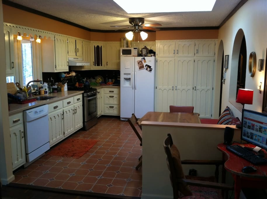 view of breakfast area and kitchen from family room
