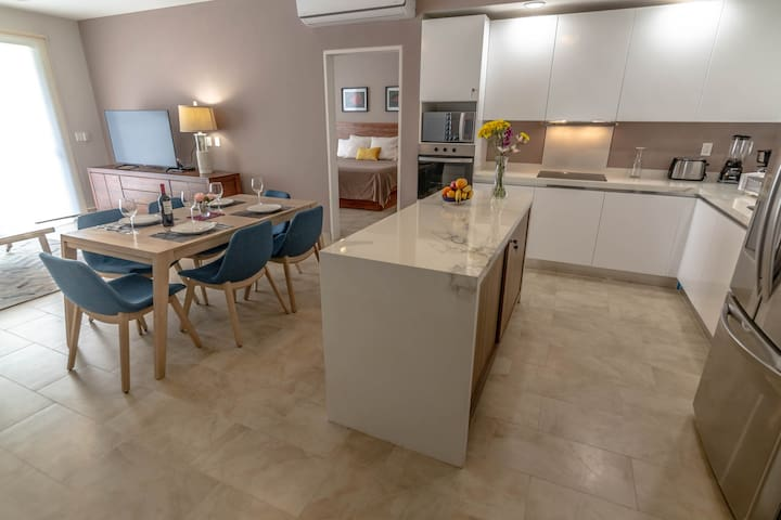 Modern kitchen and dining table for six. No gas, all electric