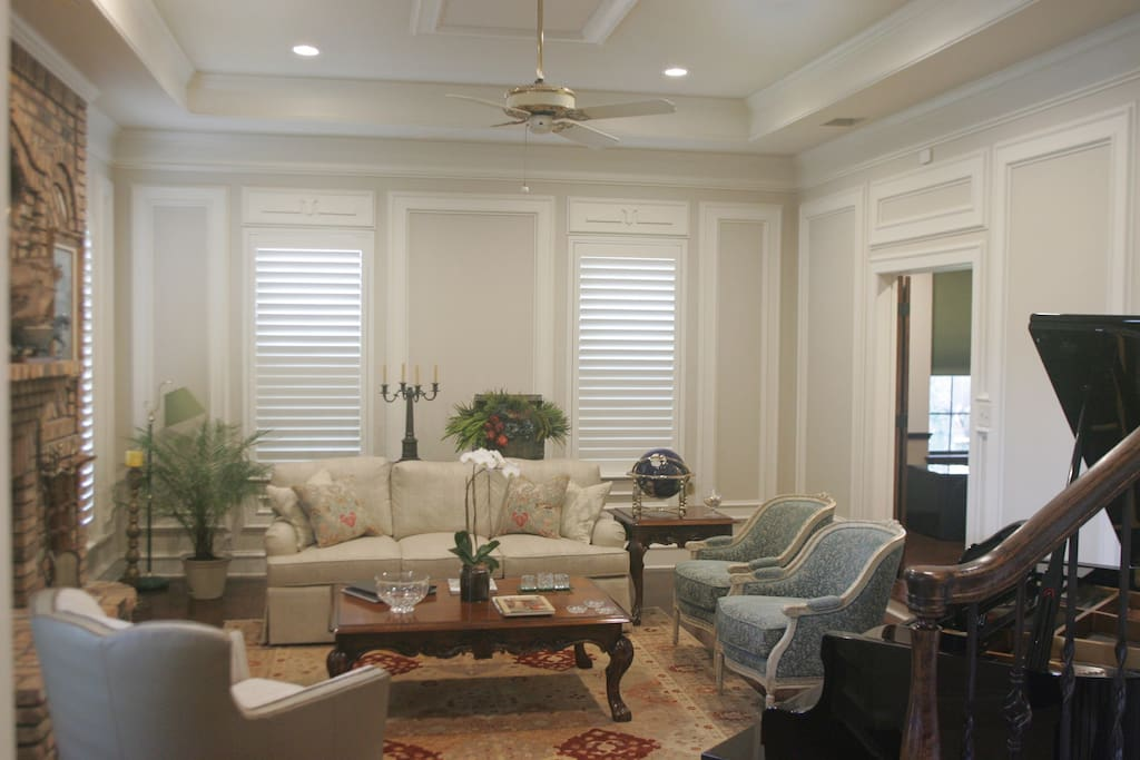 Formal Living area with Grand Piano, luxurious seating around the custom brick fireplace!