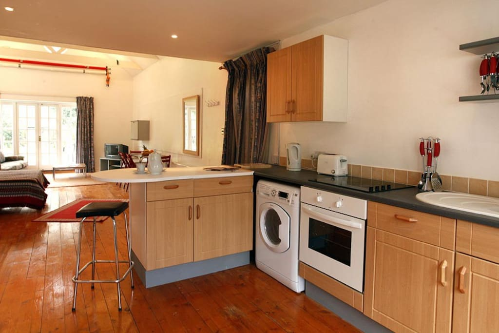 Washing machine,cooker,microwave,toaster,big Fridge freezer  and table  to dine at.