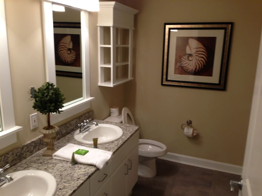 Master bath with double vanities, granite counters, large shower.