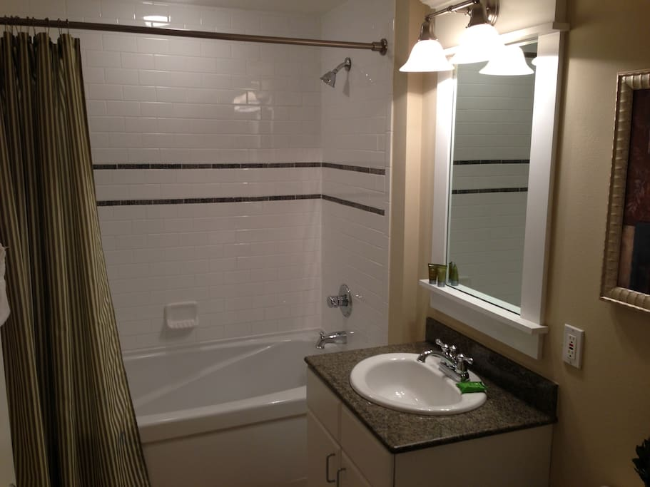 Second full bath with tub/shower combo, sink and toilet.