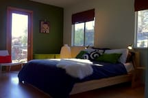 Second bedroom with private access to secluded rock garden area.