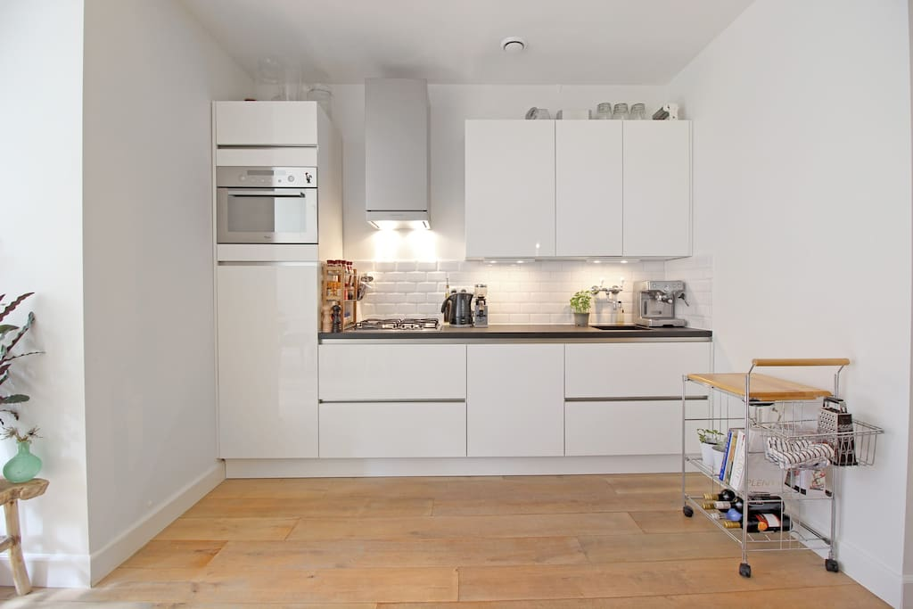 The modern kitchen is fully equipped with everything you need