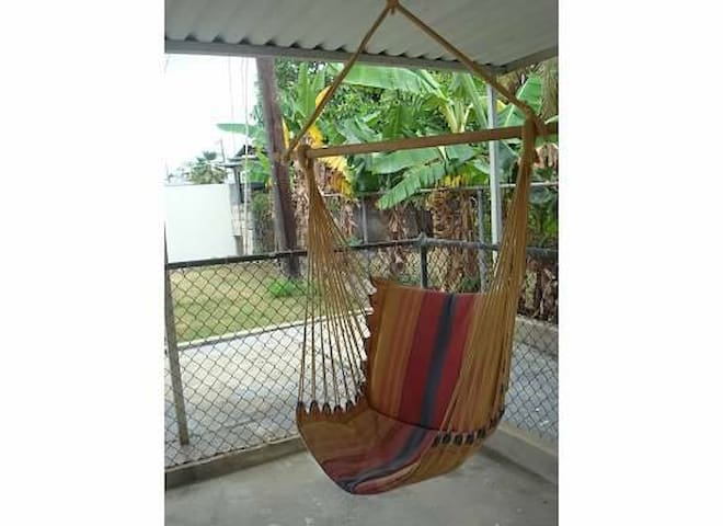 After a long day at the beach, relax in this inviting hammock.