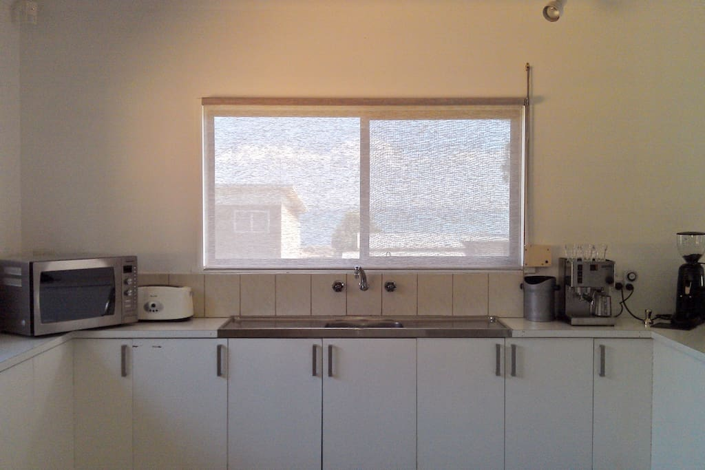Lovely kitchen with coffee machine and great view of the water