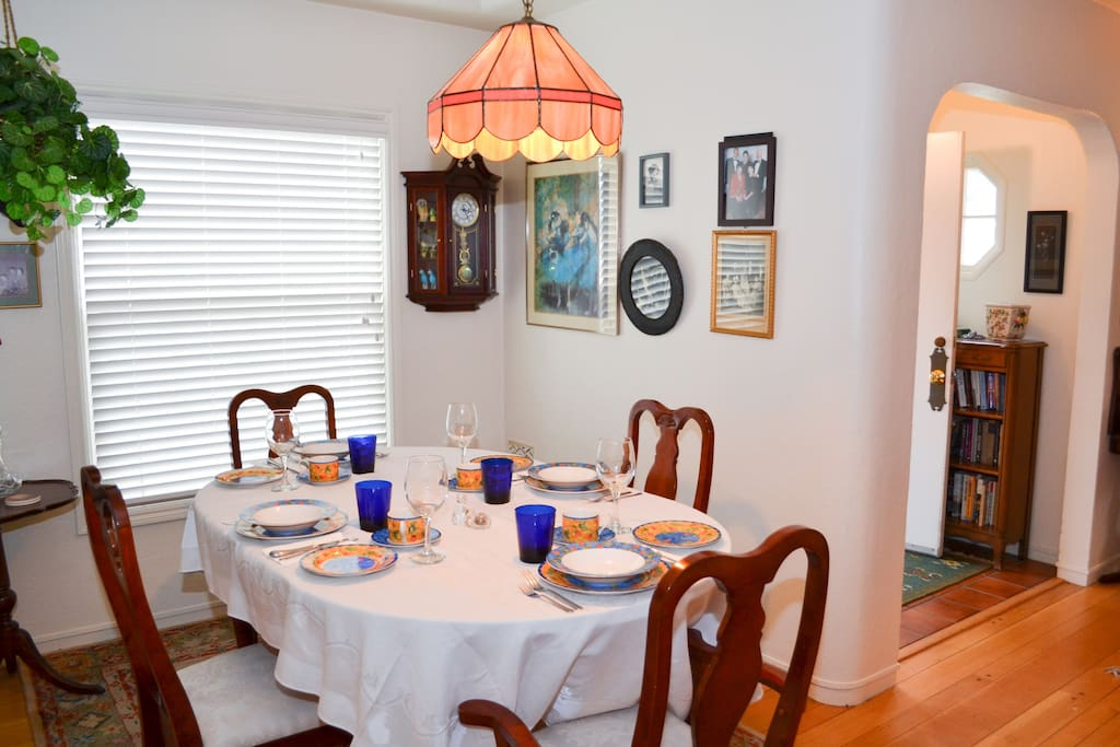 Open and airy dining room that is adjacent to kitchen.  Dining room flows into living room.