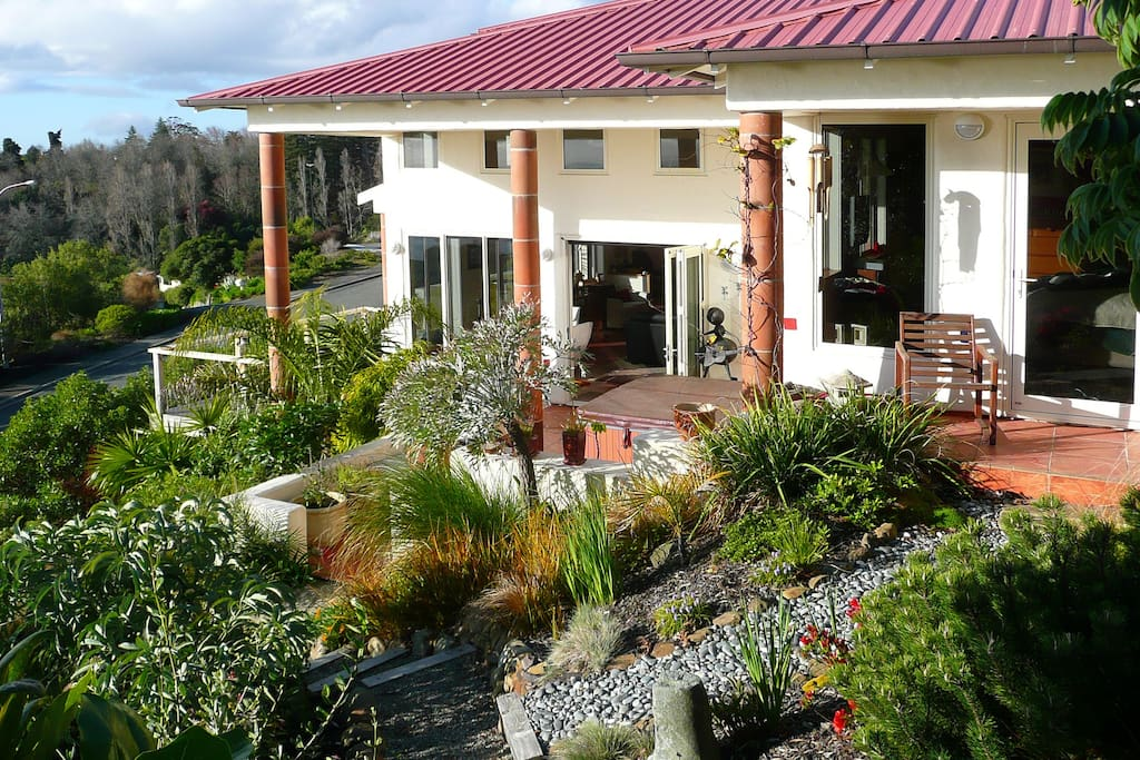 Outside: Looking back down on our home showing some of our gardens and terraces