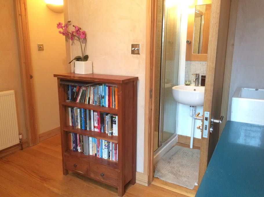 Study and kitchenette area with door to Shower and WC