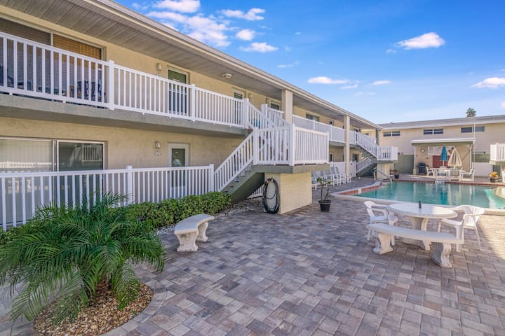 Newly updated condo overlooking the shared pool - across the street from beach!