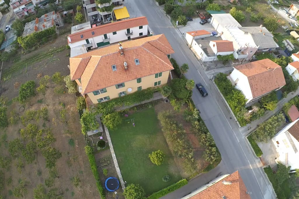 Areal view of the property, main building and garden
