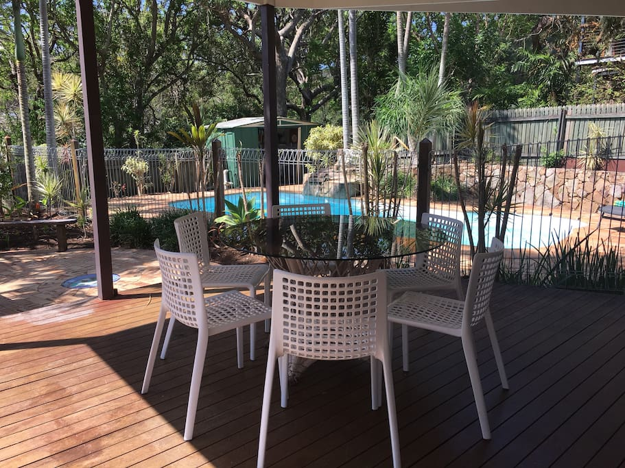 Large rear deck area overlooks the in-ground saltwater pool & provides dining furniture, BBQ & fridge.