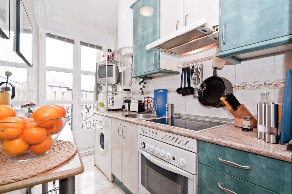 Light-filled kitchen with balcony