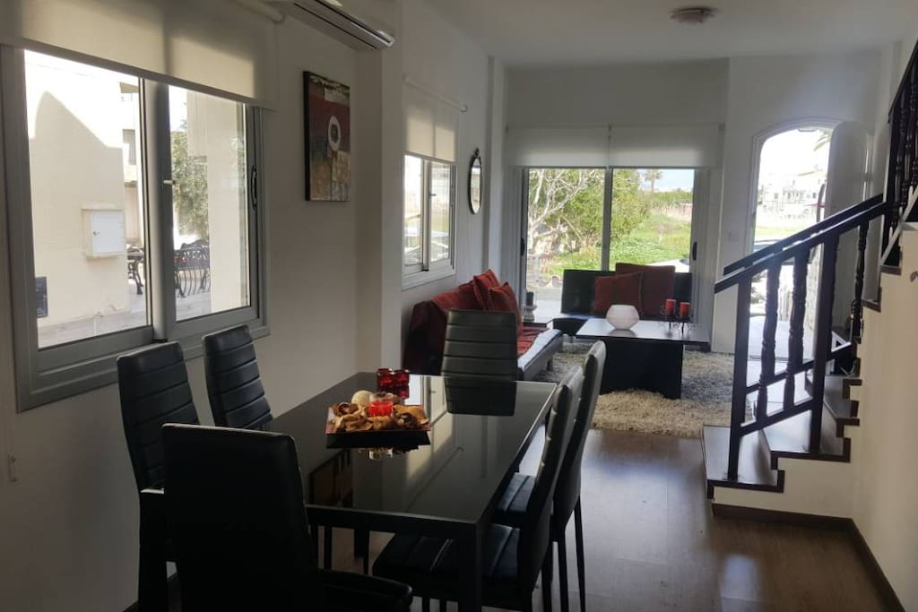 Spacious open plan living room and dining room with large balcony