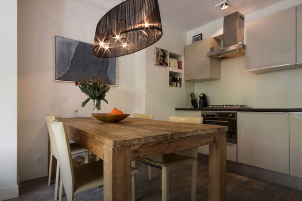 Wooden table open kitchen with dishwasher + nespresso coffee. I always leave some cups & thea