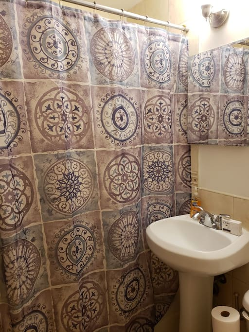 New shower curtains installed regularly and bathroom restocked with soaps and essentials.