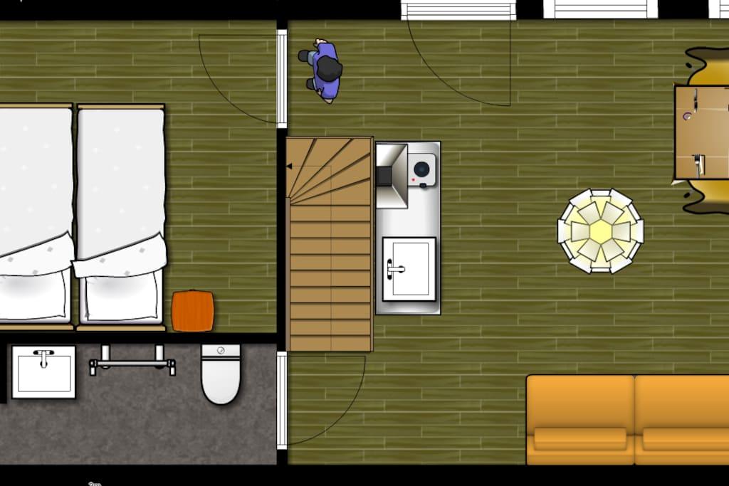 De woonkamer, badkamer en één slaapkamer op de begane grond