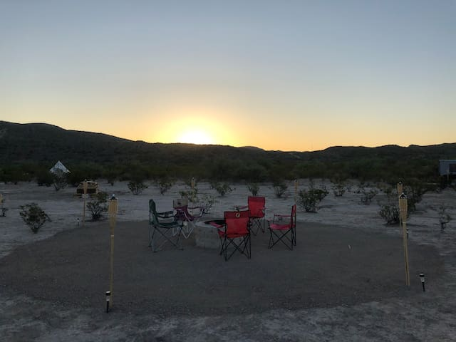 Sunrise over the ridge to the east. This is the community fire pit front and center of the property. You're welcome to hang out here and make a fire if there is no burn ban during your visit.