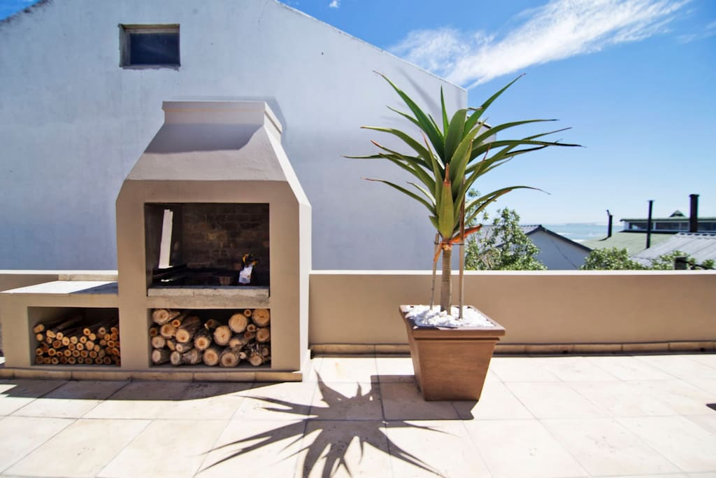 Outdoor BBQ area with sea views. Enjoy the summer and sunsets!