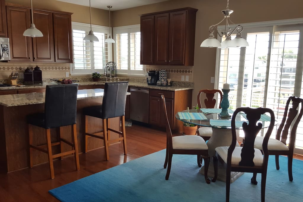 Our kitchen is a sunny place for breakfast. It has stainless steel appliances, granite counter tops, a Keurig and is well-equipped for preparing meals.