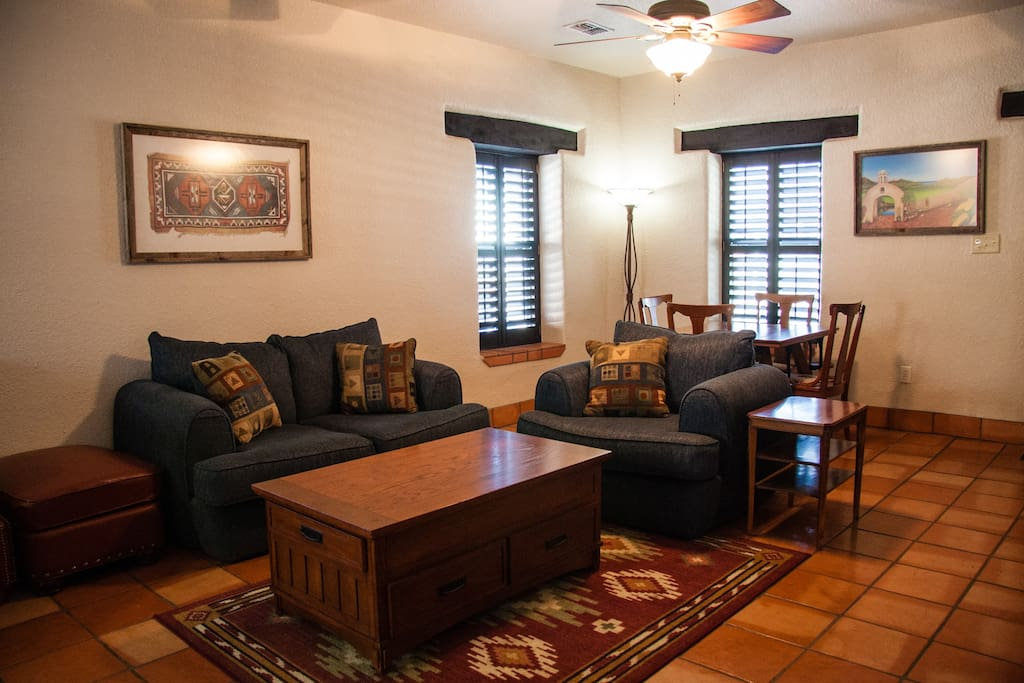 The living area features comfortable seating for relaxing, as well as a dining area.