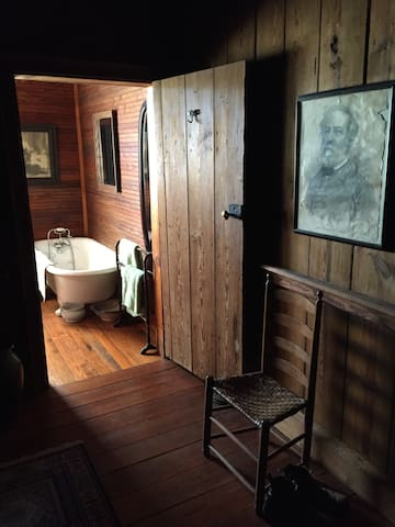 The bathroom features an original, early 20th century claw foot tub.