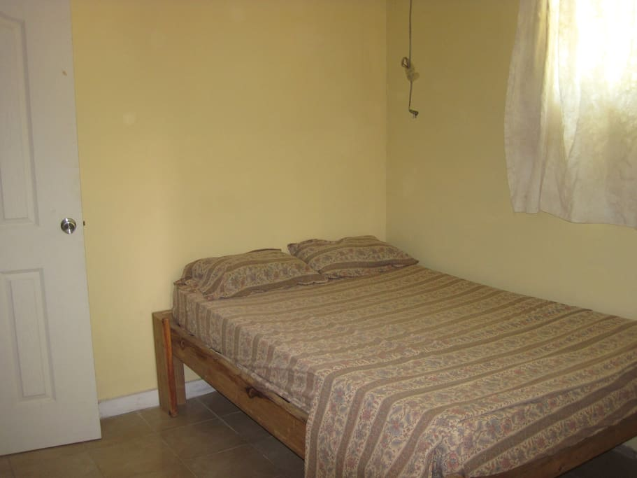 Bedroom has a double bed and ceiling fan.  A/C available for an additional $10/night.