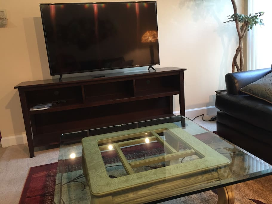 Coffee table in front of TV