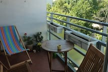 Wonderful balcony with a vaste open view with small table and chairs