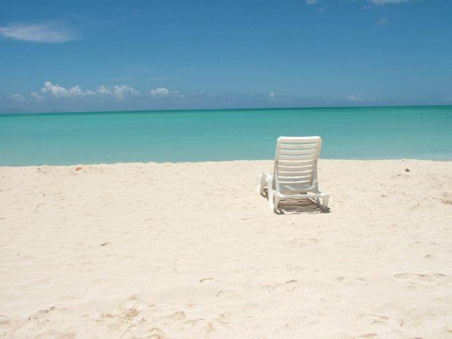 Ten minutes walk from the house to the shoreline of Turner's beach.  Here beach chairs are available for rent.