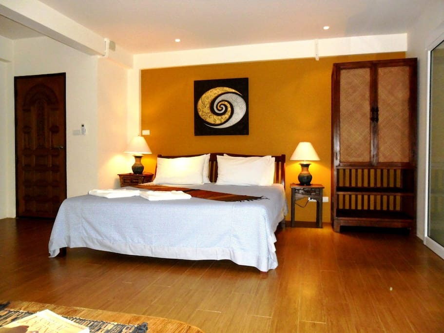 King size beds and teak furniture compliment our suites.