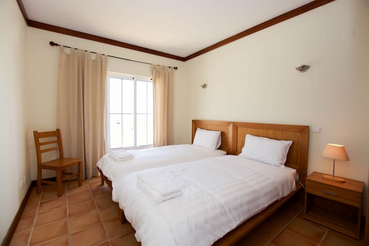Bedroom with two single bed and terrace