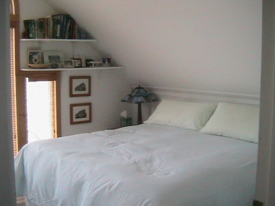The Master bedroom is situated at the beach front of home with stunning views of the lake.