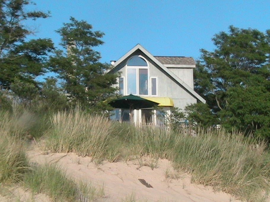 The house is right on the dune on the beach. Nothing to interrupt your view of water, water, water :)