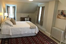 This is the large bedroom on our 3 rd floor. There is a sofa and a desk. Ample room for working.