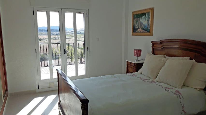 Upstairs double bedroom with Italian restored antique bedstead. French doors leading onto the upstairs terrace with fabulous views. Mirrored double wardrobe, bedside cabinet, air conditioning and ceiling fan. This is your room, can add extra bed also