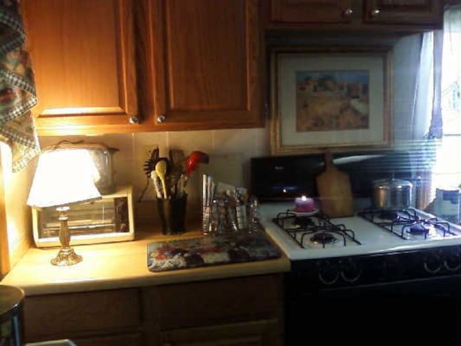 Gas stove, toaster, cabinets