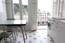 Kitchen with access to small balcony, facing East, perfect for your morning coffee.